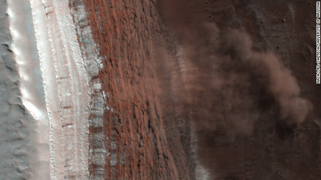 An image captured in 2008 by NASA's Mars Reconnaissance Orbiter shows at least four Martian avalanches, or debris falls, taking place. Material, likely including fine-grained ice and dust and possibly large blocks, detached from a towering cliff and cascaded to the gentler slopes below.