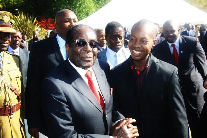 Maziwisa smiling admiringly at his nonagenarian boss  outgoing President, Robert Mugabe