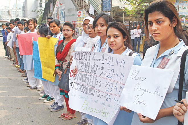 Higher secondary certificate candidates form a human chain before Jatiya Press Club in the capital yesterday demanding rescheduling four exams with adequate days in between so that they get enough time for final preparations. The exams are scheduled to be held on four consecutive days starting April 21. Photo: Star
